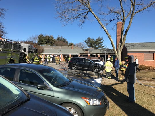 A garage fire spread to four other units on Sunday,