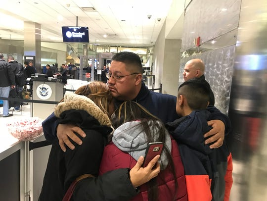 Jorge Garcia, 39, of Lincoln Park, hugs his wife, Cindy