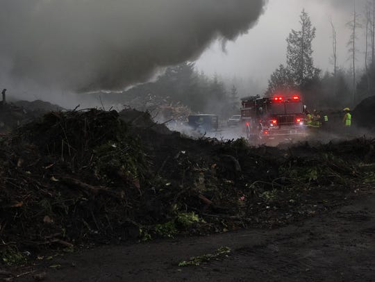 Firefighters from three fire departments responded to Sunday's second-alarm brush fire in a large pile of stumps at a composting facility between Kingston and Hansville. The fire was caused by heat from the breakdown of organic materials, according to North Kitsap Fire & Rescue.