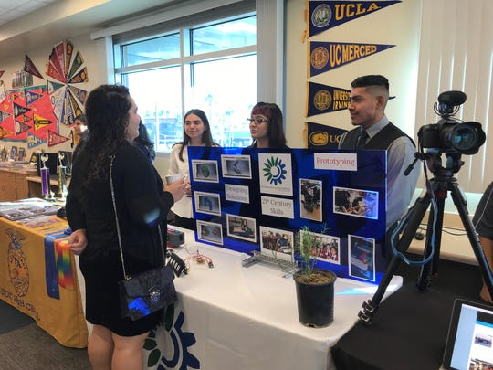 Students engage with a community member during the recent Greater Coachella Valley Chamber of Commerce breakfast at Indio High School.