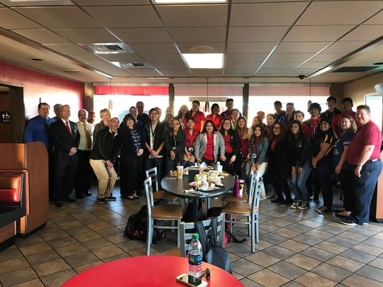 Indio High School students and staff members join Carl's Jr. President Carl Karcher in a recent photo op.