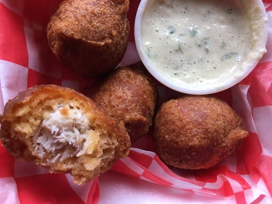The savory crab beignets are stuffed with real crab.