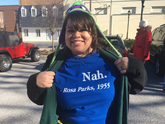Lydia Wood shows off her T-shirt before a march honoring