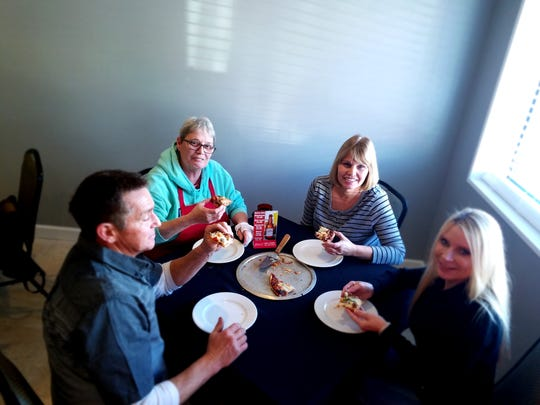 From left: Cooks Wes Fancher, Gail Schimmel, Terri Fancher, and owner Yvonne Woodburn enjoy a pizza at the newly opened Pizza Pub on North Main.