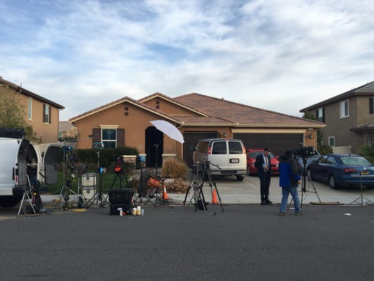 Media gathers at the Perris home where two parents
