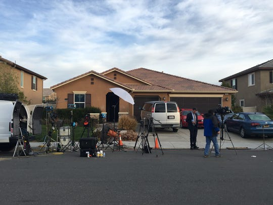 Media gathers at the Perris home where two parents were arrested Sunday after Riverside County sheriff deputies found 12 brothers and sisters chained to beds, locked up and malnourished in a dark, foul-smelling home.