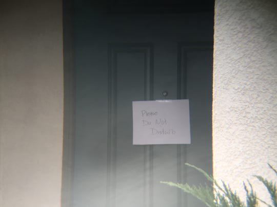 "Homes along Muir Woods Road in Perris have signs that read ""Please Do No Disturb."""