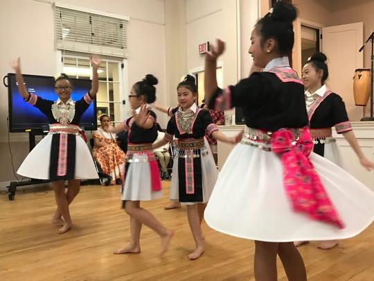 Members of the Nkauj Hmoob Paj Tshua Nplaim dance group perform at the 5th annual MLK dinner on Jan. 15, 2018.