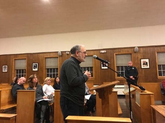 Gerald Ferraro suggests a nursing facility be part of the former Hoffmann-La Roche campus. He speaks before the Nutley Board of Commissioners on Dec. 19, 2017.