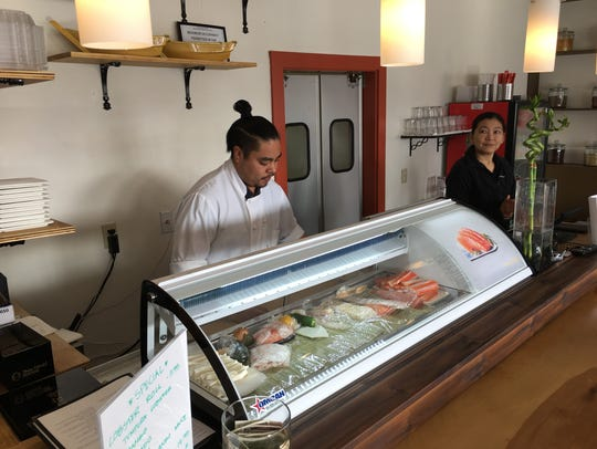 Sushi chef Oscar Martinez works alongside restaurant