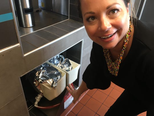 Deana Homsi points out the ketchup dispensing system