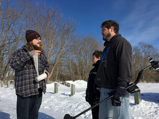 Greg Strine of Hell talks with Ryan Blevins and Cody Blevins of Dearborn Heights during a search for meteorites Thursday, Jan. 18, 2018.
