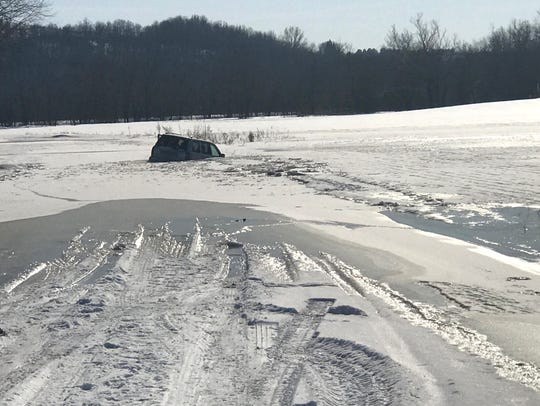 Michelle Allen's car can be seen half submerged in
