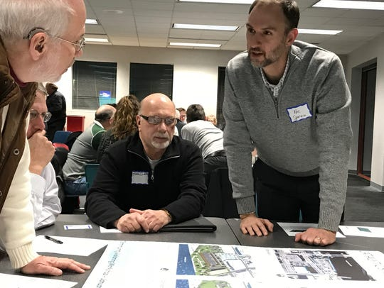 Former Community Development Director Nic Sparacio (far right) leads a group discussion about redeveloping areas of Manitowoc's downtown during a community workshop last year.
