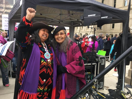 The Women's March Power to the Polls event in Lansing began with an indigenous song and drum performance by Beatrice Menasé Kwe Jackson (left) and Daisy Kostus, who are the Snowbirds, a singing group from the Saginaw Chippewa Tribe. Jan. 21, 2018.