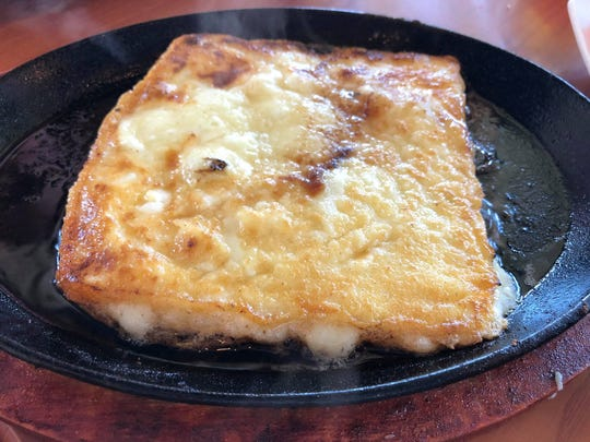 The saganaki ($10) is Kefalograviera cheese served flambe table-side.