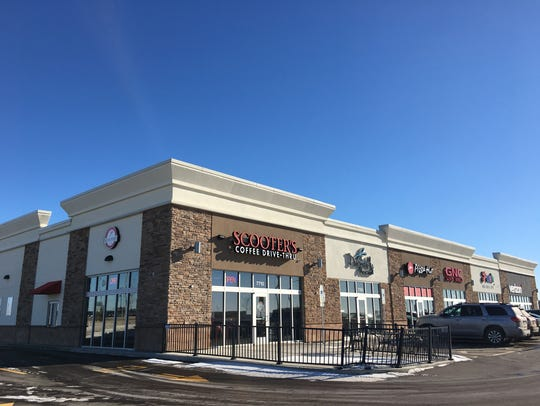 The first strip mall on the land between Walmart and