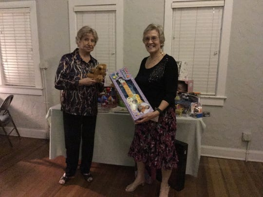 Vero Beach USA Dance Chapter 6070 board member Marge Callahan and chapter President Lorely Ridge with some of the toys given to Toys for Tots.
