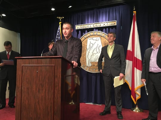 Robert Bradford speaks at a press conference about