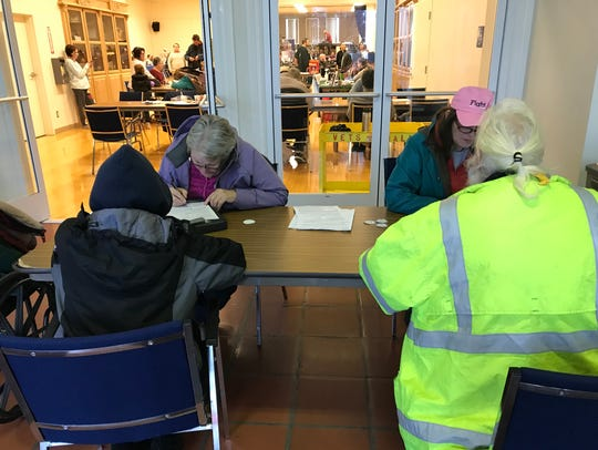 Workers were surveying those who are homeless Tuesday