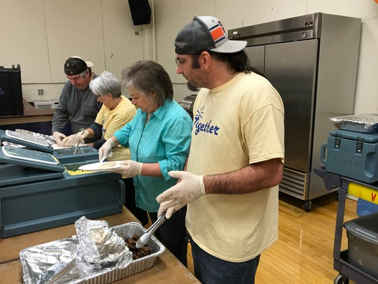 Volunteers provide free breakfasts Tuesday at the Redding