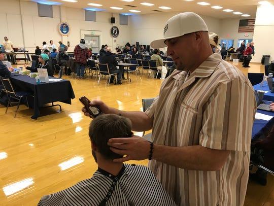 Ryan Corum of Shasta Lake provides a homeless man with