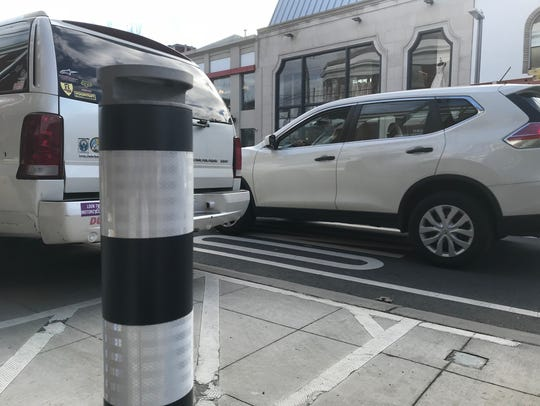Movable bollards, installed on Millburn Avenue in Millburn, were intended to create a dual use for certain parking spaces in the downtown, but have raised the ire of some residents.