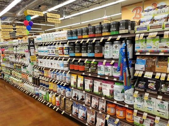 Protein Powder. So much protein powder lines a shelf at Fresh Thyme.