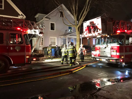 Rochester firefighters on scene on a house fire on Hawley Street Tuesday night.