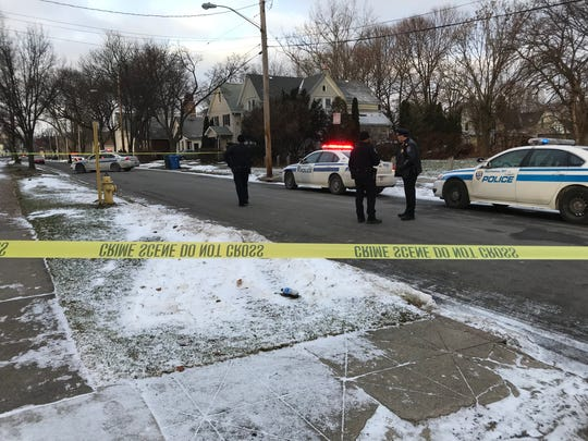 Rochester police gather on Second Street at the scene of a double shooting Wednesday afternoon.