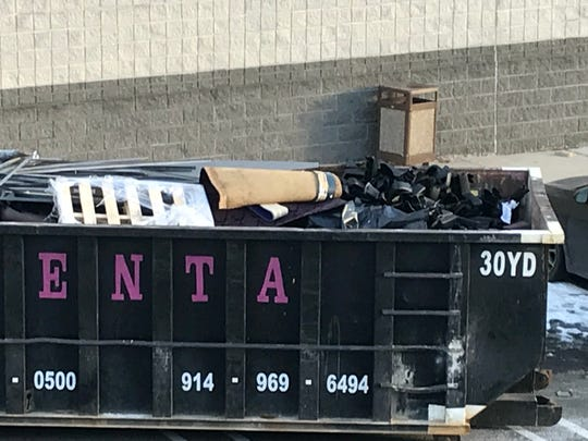 A Dumpster filled with renovation debris from the Multiplex Cinemas at the Cross County Shopping Center in Yonkers on Jan. 19, 2018.