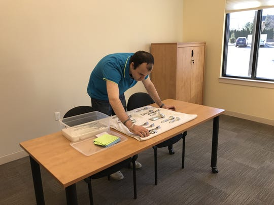 Justin, an adult learner at the Institute for Educational Achievement, learns how to work with silverware for his job at a catering company. The new life-skills facility for adults with autism opened in New Milford, NJ.