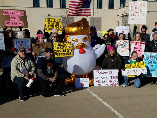 Members of Indivisible Iowa and others protest the