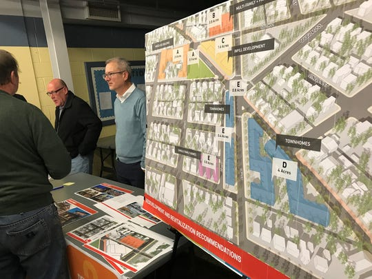 Dennis Carson, right, Lafayette's economic development director, discusses possibilities for the Five Points area during an open house Thursday at Jenks Rest at Columbian Park.