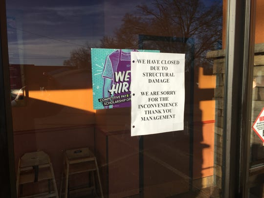Signs on the door at the Prattville Taco Bell say the business is closed due to structural damage.