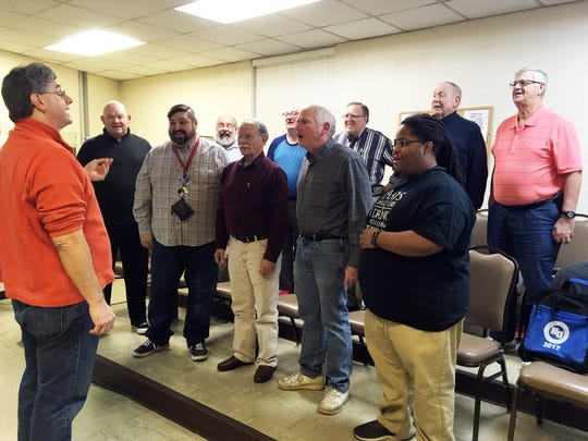 "Director Lee Franks takes the Smokyland Chorus through ""Heart of My Heart."" Shown left to right, front, are Jimmy Gregg, J.J. Duffy, Ron DuBois, Kent Peebles and Kardero Jeffries; (rear) David Frey, Jim Wilhelm, Gerry Klima, Gene Henry and John Shelton."