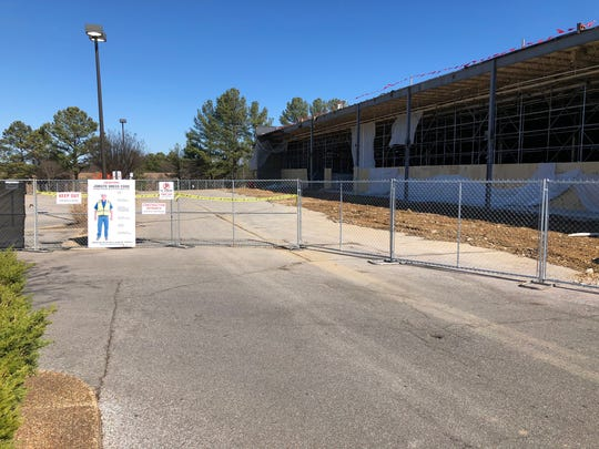 The building facade is gone from the old Kroger site on Exeter in Germantown and a fence surrounds the property.