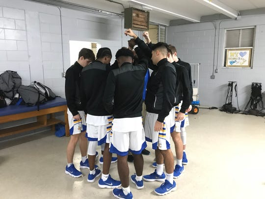 John Carroll Catholic players huddle in the locker room  before playing Westminster Academy on Tuesday, Jan. 23, 2018 in Fort Pierce.