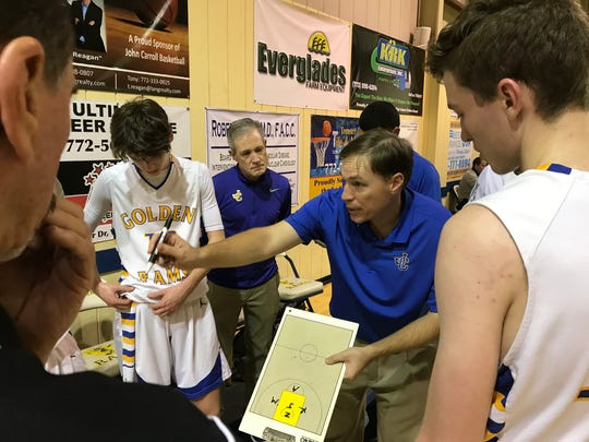 John Carroll coach Jimmy Hebb gives instruction during a timeout during a game against Westminster Academy on Tuesday, Jan. 23, 2018 in Fort Pierce.