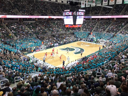 "On Jan. 26, Michigan State students at Breslin Center replaced their ""Izzone"" t-shirts with teal to show support for the victims of Larry Nassar. The MSU men's basketball team beat Wisconsin that night."