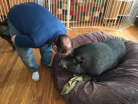 Ypsilanti resident Jeffery Rowland, 42, leans down