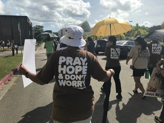 Hundreds of Catholics marched to the Guam Legislature