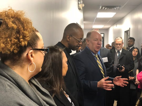 Elizabeth Mayor Chris Bollwage shares with former Roselle Mayor Garrett Smith and advocates the difficulties of securing identification and a driver's license upon release from prison.