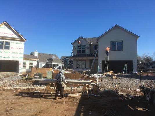 Crews building houses