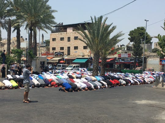 Thousands of Palestinians, Muslim and Christian, peacefully