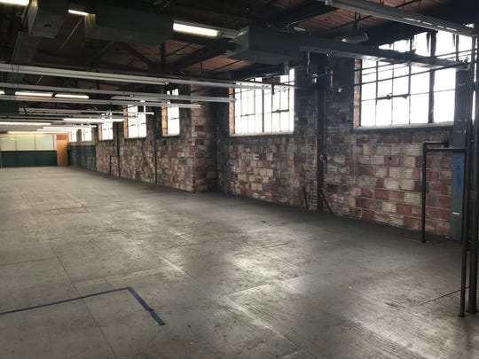 Urban Systems plans to redevelop the warehouse at the corner of Hosmer and Hazel Street in Lansing into apartments and office space. Pictured here on Jan. 30.