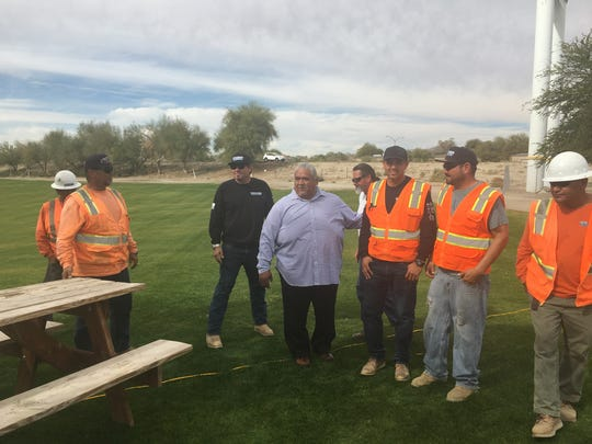 Tribal Chairman Darrell Mike of the 29 Palms Band of Mission Indians chatting with construction workers on site.