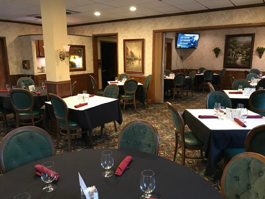The dining room in the historic Port Hotel has a more
