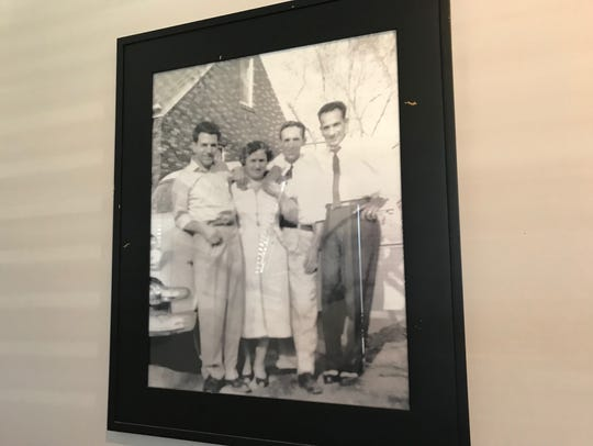 Family photographs line the walls at Mama Lacona's