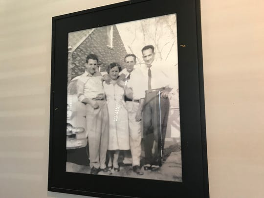 Family photographs line the walls at Mama Lacona's in Urbandale.
